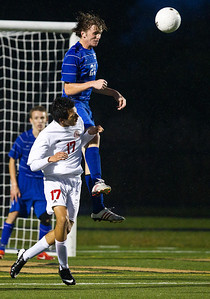 Kyle Grillot - kgrillot@shawmedia.com  Marian Central sophomore Fermado Tapia (17) cant stop Vernon Hills senior Nick Bryson (21) from controlling the ball during the class 2A boys soccer semifinal match between Marian Central and Vernon Hills Wednesday, October 30, 2013. Vernon Hills won the match 10-0.