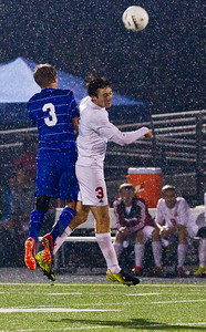 Kyle Grillot - kgrillot@shawmedia.com  Vernon Hills senior (left) fights through Marian Central junior Connor Hull (right) and senior Riley Blaz during the class 2A boys soccer semifinal match between Marian Central and Vernon Hills Wednesday, October 30, 2013. Vernon Hills won the match 10-0.