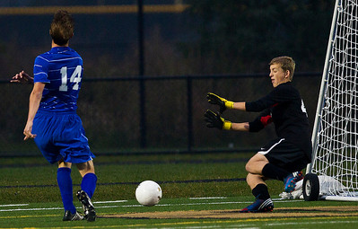 Kyle Grillot - kgrillot@shawmedia.com  Vernon Hills senior David White (14) misses a shot at goal during the class 2A boys soccer semifinal match between Marian Central and Vernon Hills Wednesday, October 30, 2013. Vernon Hills won the match 10-0.