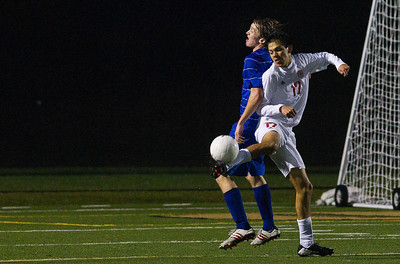 Kyle Grillot - kgrillot@shawmedia.com  Marian Central sophomore Fermado Tapia (17) kicks the ball away from Vernon Hills senior Nick Bryson (21)  during the class 2A boys soccer semifinal match between Marian Central and Vernon Hills Wednesday, October 30, 2013. Vernon Hills won the match 10-0.