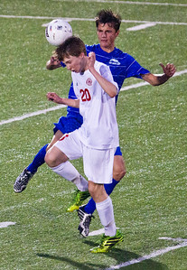 Kyle Grillot - kgrillot@shawmedia.com  Marian  Central sophomore Bryan Hart heads the ball away from the Vernon Hills defense during the class 2A boys soccer semifinal match between Marian Central and Vernon Hills Wednesday, October 30, 2013.  Vernon Hills won the match 10-0.