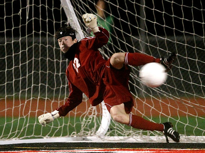 Kyle Grillot - kgrillot@shawmedia.com  Dekalb's Eric Ngum fails to stop McHenry senior Ryan Uhl's shot during an overtime shootout of a class 3A boys soccer semifinal match between McHenry and Dekalb Wendesday, October 30, 2013.  McHenry won the shootout, 4-2, after a 1-1 tie through two overtimes.