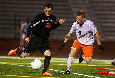 Kyle Grillot - kgrillot@shawmedia.com  Dekalb's Skylar Weishaar tries to stop McHenry senior Kyle Marsh from passing the ball during the second half of the class 3A boys soccer semifinal match between McHenry and Dekalb Wendesday, October 30, 2013.  McHenry won the shootout, 4-2, after a 1-1 tie through two overtimes.