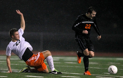 Kyle Grillot - kgrillot@shawmedia.com  Dekalb's Rasmus Hage falls while chasing McHenry senior Kyle Marsh during a class 3A boys soccer semifinal match between McHenry and Dekalb Wednesday, October 30, 2013.  McHenry won the shootout, 4-2, after a 1-1 tie through two overtimes.