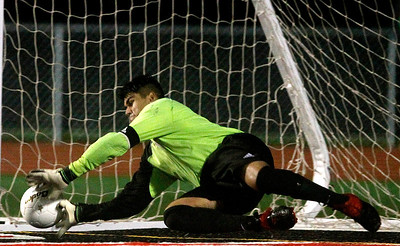 Kyle Grillot - kgrillot@shawmedia.com  McHenry senior Frankie Valle blocks the winning shot in an overtime shootout during a class 3A boys soccer semifinal match between McHenry and Dekalb Wednesday, October 30, 2013.  McHenry won the shootout, 4-2, after a 1-1 tie through two overtimes.
