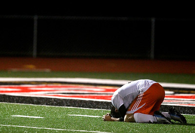 Kyle Grillot - kgrillot@shawmedia.com  Dekalb's Sean Woodford falls to the ground after missing the game-ending shot during the overtime shootout of a class 3A boys soccer semifinal match between McHenry and Dekalb Wendesday, October 30, 2013.  McHenry won the shootout, 4-2, after a 1-1 tie through two overtimes.