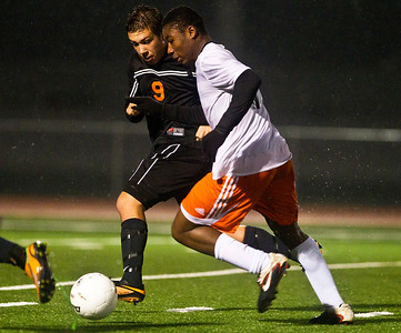 Kyle Grillot - kgrillot@shawmedia.com  McHenry senior Ryan Uhl's and Dekalb's Akim Suraji fight to control the ball during the first overtime of the class 3A boys soccer semifinal match between McHenry and Dekalb Wendesday, October 30, 2013.  McHenry won the shootout, 4-2, after a 1-1 tie through two overtimes.