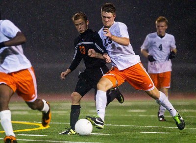 Kyle Grillot - kgrillot@shawmedia.com  McHenry senior freshman James Mulhall and Dekalb's Rasmus Hage fight to control the ball during the first overtime of the class 3A boys soccer semifinal match between McHenry and Dekalb Wendesday, October 30, 2013. McHenry won the shootout, 4-2, after a 1-1 tie through two overtimes.