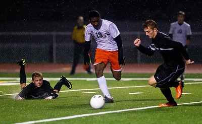 Kyle Grillot - kgrillot@shawmedia.com  Dekalb's Akim Suraji fight to control the ball during the first overtime of a class 3A boys soccer semifinal match between McHenry and Dekalb Wendesday, October 30, 2013.  McHenry won the shootout, 4-2, after a 1-1 tie through two overtimes.