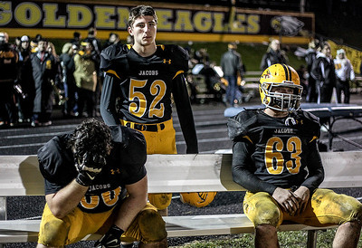 Sarah Nader- snader@shawmedia.com Jacobs' Jonny Cieniewicz (left), Sam Leonard and Carson Shoemaker watch the last minutes of Friday's playoff game against Conant in Algonquin November 1, 2013. Conant defeated Jacobs, 42-35.
