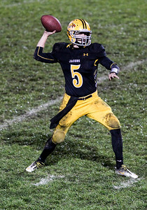 Sarah Nader- snader@shawmedia.com Jacobs' quarterback Bret Mooney throws a pass during the third quarter of Friday's playoff game against Conant in Algonquin November 1, 2013. Conant defeated Jacobs, 42-35.