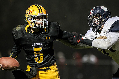 Sarah Nader- snader@shawmedia.com Jacobs' quarterback Bret Mooney runs the ball during the second quarter of Friday's playoff game against Conant in Algonquin November 1, 2013. Conant defeated Jacobs, 42-35.