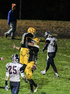 Sarah Nader- snader@shawmedia.com Jacobs' quarterback Bret Mooney (right) celebrates after scoring a touchdown during the third quarter of Friday's playoff game against Conant in Algonquin November 1, 2013. Conant defeated Jacobs, 42-35.