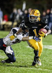 Sarah Nader- snader@shawmedia.com Conant's Mike Kos (left) tackles Jacobs' Josh Walker during the first quarter of Friday's playoff game in Algonquin November 1, 2013. Conant defeated Jacobs, 42-35.