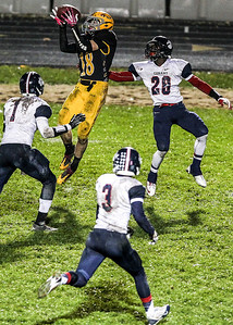 Sarah Nader- snader@shawmedia.com Jacobs' Camden McLain (left) catches a pass during the third quarter of Friday's playoff game against Conant in Algonquin November 1, 2013. Conant defeated Jacobs, 42-35.