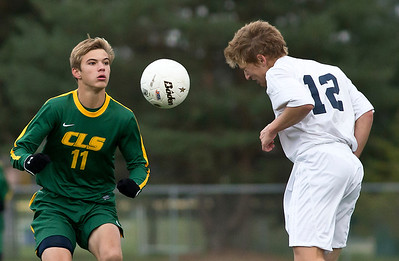 Cary Grove's Matt Scott  heads the ball past Crystal Lake South's Stefan Harris during the first period of the Regional Semi final match at Crystal Lake South on Wednesday. Crystal Lake South defeated Cary Grove 3-2 in Overtime. Brett Moist/for the Northwest Herald