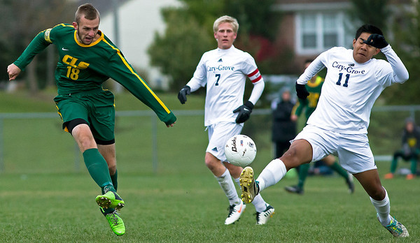 Crystal Lake South's Gary Sexson kicks the ball past Cary Grove's Israel Lopez during the first period of the Regional Semi final match at Crystal Lake South on Wednesday. Crystal Lake South defeated Cary Grove 3-2 in Overtime. Brett Moist/for the Northwest Herald