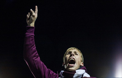 Kyle Grillot - kgrillot@shawmedia.com   Marengo senior Dylan Marks leads the student section in a  cheer during the third quarter of the homecoming game against Burlington Central Friday October 3, 2014 in Marengo. Marengo lost to Burlington Central, 21-13.