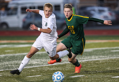 Sarah Nader - snader@shawmedia.com Boylan's Zach Robinson (left) and Crystal Lake South's Andrew Grabowski case after the ball during the second half of Wednesday's Class 3A Dekalb Sectional at Dekalb High School October 29, 2014. Boylan won, 1-0.