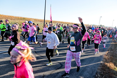 Michelle LaVigne/ For Shaw Media Participants of the Care4 Breast Cancer 5K Run/Walk begin the race on October 18, 2015 in Woodstock,Ill.