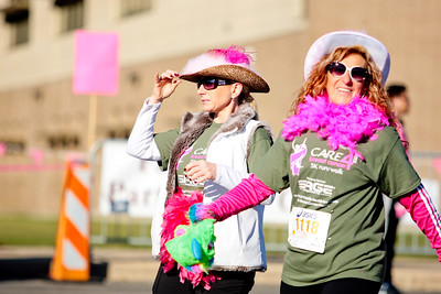 Michelle LaVigne/ For Shaw Media Stacey Webster of Lake in the Hills (left,) and Debbie Payne of Hannover Park approach the finish line during the Care4 Breast Cancer 5K Run/Walk to benefit the women of McHenry County by providing breast cancer care through the Family Health Partnership Clinic on October 18, 2015 in Woodstock,Ill.