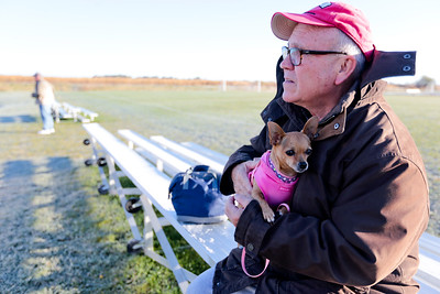 Michelle LaVigne/ For Shaw Media Steve Ford of Wauconda waits with his dog Rosie to cheer on his wife, two grand daughters, daughter and son-in-law, all participating in the the Care4 Breast Cancer 5K Run/Walk to benefit the women of McHenry County by providing breast cancer care through the Family Health Partnership Clinic on October 18, 2015 in Woodstock,Ill.