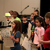 Geneva Christian School second-grader Jane Acuna reads a statement with her classmates about their local heroes during the school's Hero Day Wednesday morning. The all-school presentation honored heroes in the community including police officers and elected officials.