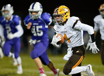 Trevor Fitzsimmons (4) from Jacobs out runs Hampshire players for a touchdown on the first kickoff of the game in the first quarter of their game at Hampshire High School on Friday, October 21, 2016 in Hampshire.  John Konstantaras photo for the Northwest Herald