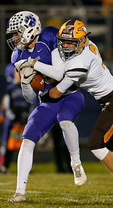 Erik Starrenburg (9) from Hampshire is tackled by Aidan Ludlum (3) from Jacobs after making a first down catch during the first quarter of their game at Hampshire High School on Friday, October 21, 2016 in Hampshire.  John Konstantaras photo for the Northwest Herald