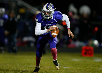 Quarterback Jacob Vincent (12) from Hampshire scrambles with the ball during the third quarter of their game against Jacobs at Hampshire High School on Friday, October 21, 2016 in Hampshire.  John Konstantaras photo for the Northwest Herald