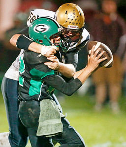 Edwin Yockey (56) from Hiawatha sacks Brad Judson (42) from Alden-Hebron during the fourth quarter of their game at Alden-Hebron High School on Friday, September 30, 2016 in Hebron, Ill. The Hawks defeated the Green Giants 21-6.  John Konstantaras photo for the Northwest Herald