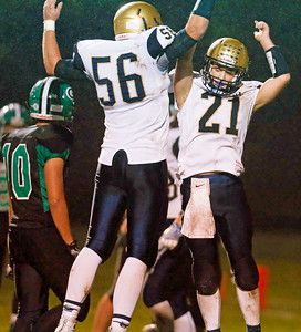 Braden Watson (21) from Hiawatha celebrates his touchdown with Edwin Yockey (56) during the second quarter of their game against Alden-Hebron at Alden-Hebron High School on Friday, September 30, 2016 in Hebron, Ill. The Hawks defeated the Green Giants 21-6.  John Konstantaras photo for the Northwest Herald