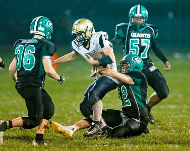 Braden Watson (21) from Hiawatha is tackled by Jacob Boehlen (52) from Alden-Hebron during the fourth quarter of their game at Alden-Hebron High School on Friday, September 30, 2016 in Hebron, Ill. The Hawks defeated the Green Giants 21-6.  John Konstantaras photo for the Northwest Herald