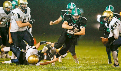 Mason Mindham (36) from Alden-Hebron breaks a tackle by Riley O'hern (6) from Hiawatha for a 8 yard first down run during the third quarter of their game at Alden-Hebron High School on Friday, September 30, 2016 in Hebron, Ill. The Hawks defeated the Green Giants 21-6.  John Konstantaras photo for the Northwest Herald