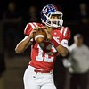 Marmion Academy's Brandon McPherson looks to throw against Fenwick on Sept. 30 in Aurora