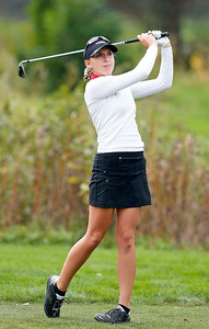 John Konstantaras - For Shaw Media Marian Central's Sophia Archos watches her drive from the second tee during the Johnsburg Girls Golf Regional at Boone Creek Golf Club on Wednesday, October 5, 2016 in Bull Valley, Ill.