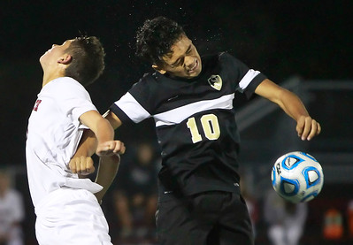 Candace H. Johnson-For Shaw Media Antioch's Bart Krumpos goes up for a header against Grayslake North's Carlos Alfaro in the first half at Antioch Community High School.