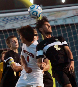 Candace H. Johnson-For Shaw Media Antioch's Zac Tholen goes up for a header against Grayslake North's Cristian Guerrero in the first half at Antioch Community High School.