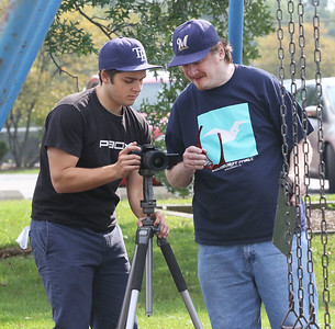 "Candace H. Johnson-For Shaw Media George Bicknell, of Chicago, director of photography, and Brian Naydol, of Antioch, director, position their Lumix camera to film Scene 13 of their horror movie called, ""Tread This Fantasy"" at Caboose Park in Lake Villa."