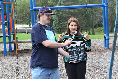"Candace H. Johnson Director Brian Naydol, of Antioch uses a slate to start filming Scene 13  in front of lead actress, Jessica Trznadel, of Westchester, in the horror film, ""Tread This Fantasy"" at Caboose Park in Lake Villa."