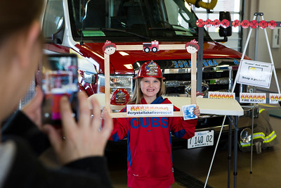 Mike Greene - For Shaw Media  Makayla Basham, 7 of Crystal Lake, poses for a photo for her mom Rachel during the Crystal Lake Fire Rescue Open House Saturday, October 8, 2016 at Crystal Lake Fire Rescue Station 1 in Crystal Lake. The annual event featured station tours, fire extinguisher demos, hands only CPR, Flight for Life helicopter tours as well as gear demos, sonar rescue and dive rescue demos, and kid's obstacle courses.