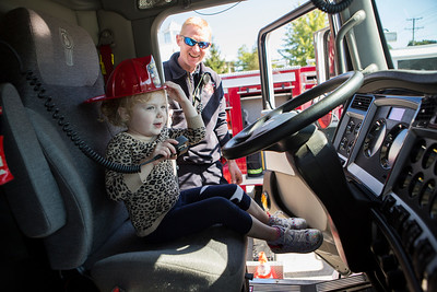 Mike Greene - For Shaw Media  Audrey Ahlstrom, 4 of Crystal Lake, talks on the radio while touring a fire engine during the Crystal Lake Fire Rescue Open House Saturday, October 8, 2016 at Crystal Lake Fire Rescue Station 1 in Crystal Lake. The annual event featured station tours, fire extinguisher demos, hands only CPR, Flight for Life helicopter tours as well as gear demos, sonar rescue and dive rescue demos, and kid's obstacle courses.
