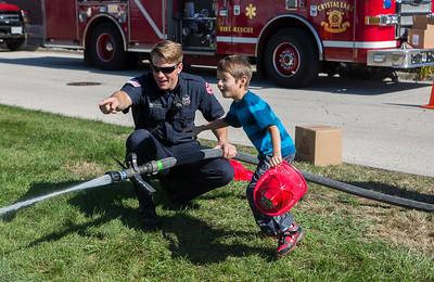 Mike Greene - For Shaw Media  James Gualdoni, left of the Crystal Lake Fire Department, points out a missed fire to Gabriel Garcia, 6 of Crystal Lake, during the Crystal Lake Fire Rescue Open House Saturday, October 8, 2016 in Crystal Lake. The annual event featured station tours, fire extinguisher demos, hands only CPR, Flight for Life helicopter tours as well as gear demos, sonar rescue and dive rescue demos, and kid's obstacle courses.