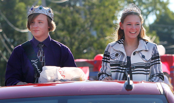 Candace H. Johnson-For Shaw Media Grant's King and Queen, R.J. Axen and Haley Fry, make their way down Grand Avenue during the Homecoming Parade in Fox Lake.