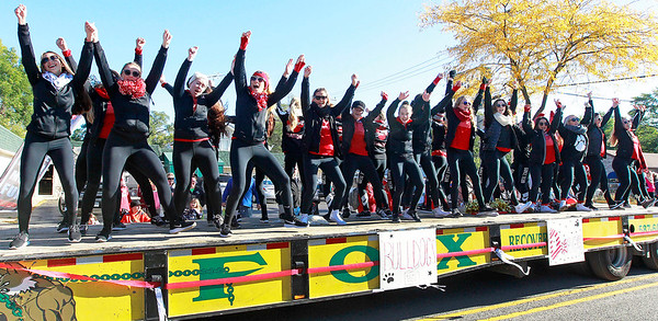 Candace H. Johnson-For Shaw Media Grant's dance team keeps moving on their float during the Homecoming Parade down Grand Avenue in Fox Lake.