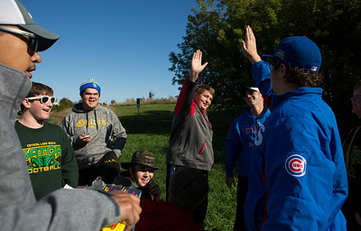 Mike Greene - For Shaw Media  Caden Slominski, center,16 of Crystal Lake, high-fives teammate Max Klinsky, right, 17 of Crystal Lake after being awarded a prize in the beginner divistion during the 5th Annual Disc Golf Tournament Saturday, October 8, 2016 at Linda K. Fischer Park in Lake in the Hills. The event featured beginner and amateur divisions with top 2 team finishers being awarded prizes.