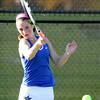 St. Charles North's Shelby Thomas hits a return while playing for third place in No. 1 singles during the UEC tournament at St. Charles East on Oct. 8.