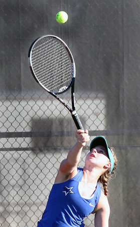 St. Charles North's Kate Boeke serves while playing for the No. 2 singles championship during the UEC tournament at St. Charles East on Oct. 8.