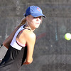 St. Charles East's Katie McCarthy hits a return while playing for third place in No. 2 singles during the UEC tournament at St. Charles East on Oct. 8.