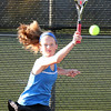 Geneva's Caroline Lahey hits a return while playing for the No. 1 singles championship during the UEC tournament at St. Charles East on Oct. 8.